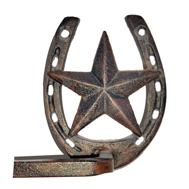a pair of western rodeo themed cowboy style towel bars for your bathroom or pool house and especially for your stable or...