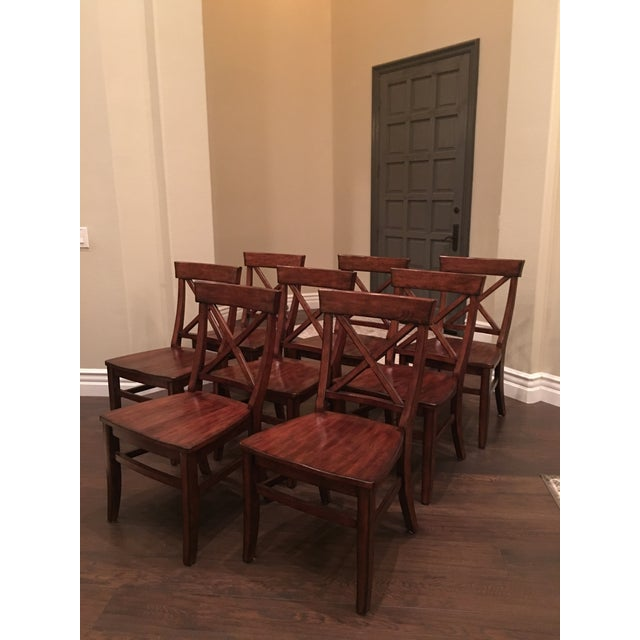 8 Aaron wood seat side chairs from Pottery Barn in Rustic Mahogany. Excellent condition with the exception of a scratch on...
