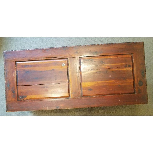 Carved Panel Cedar Chest Wood chest having cedar panels, carved decorative trim, ornate molded metal handles, a lock and...