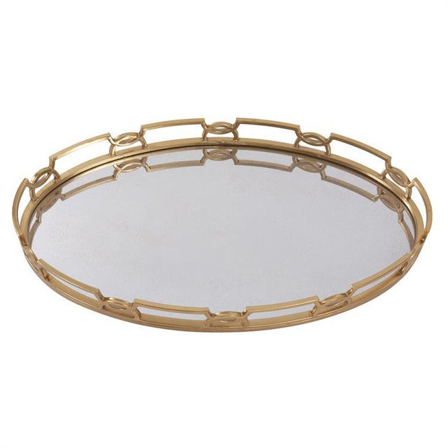 """The Bright Gold Metal Tray features an open work decorative edge that surrounds a mirrored surface. The entire frame is..."