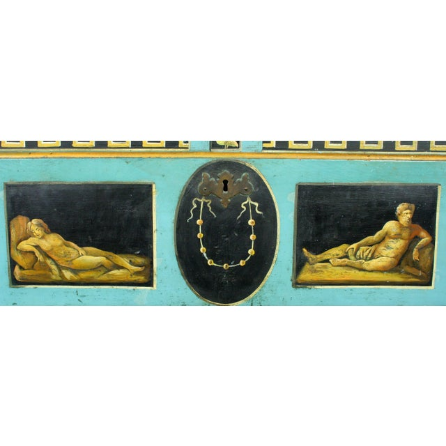 A magnificent neoclassical hand-painted pine chest with vibrant, blue, gold and black coloration. the top is faux hand-...