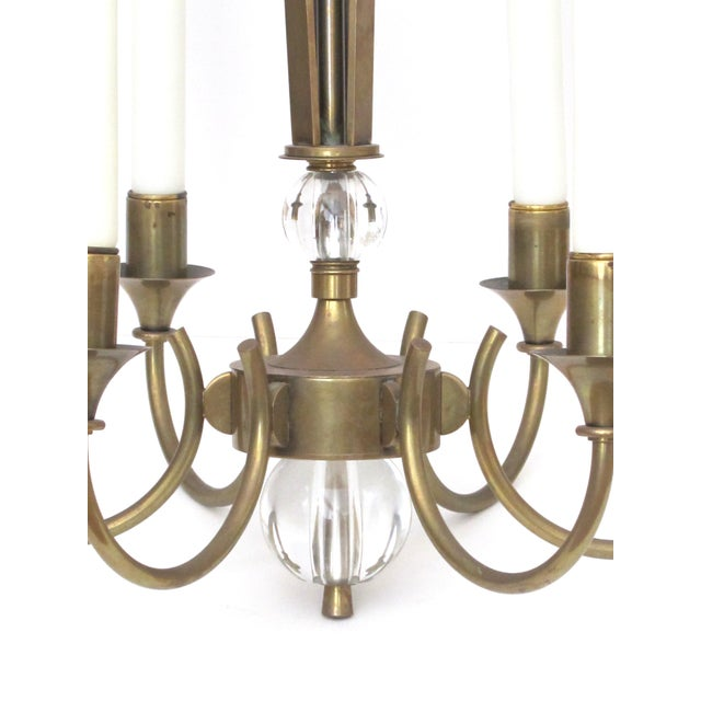 the tapering openwork support above 6 scrolled arms ending in a glass orb pendant knob