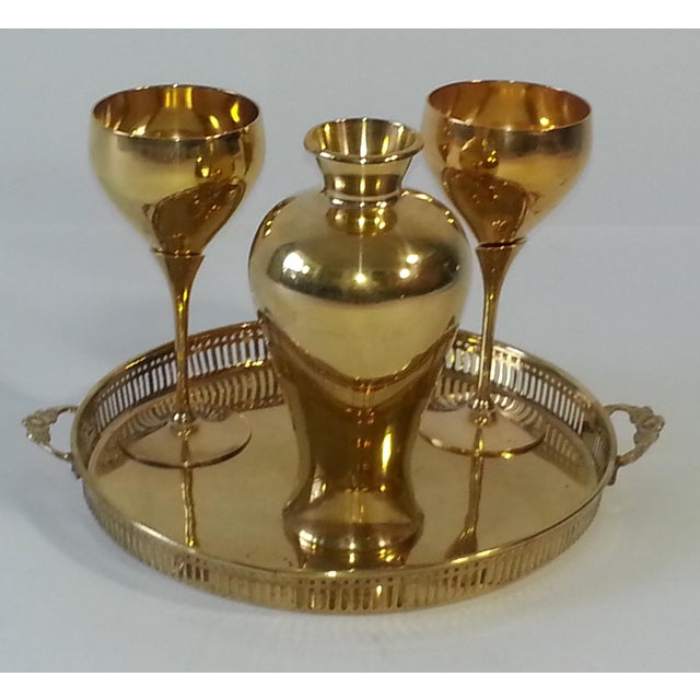 This item consists of a set of four brass pieces, including two 2-toned brass goblets, a small brass vase, and a brass...