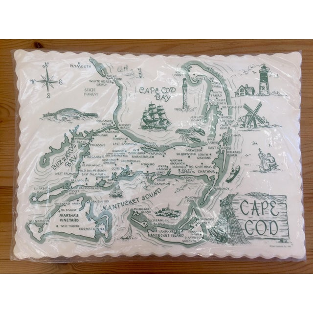 New in the original packaging, a set of 36 paper placemats featuring Cape Cod, Massachusetts. These vintage scalloped edge...