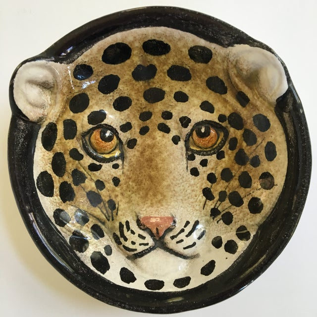 This is a mid century, hand painted, spotted Leopard faced pottery dish/bowl/catchall made in Italy. Stamped on the...