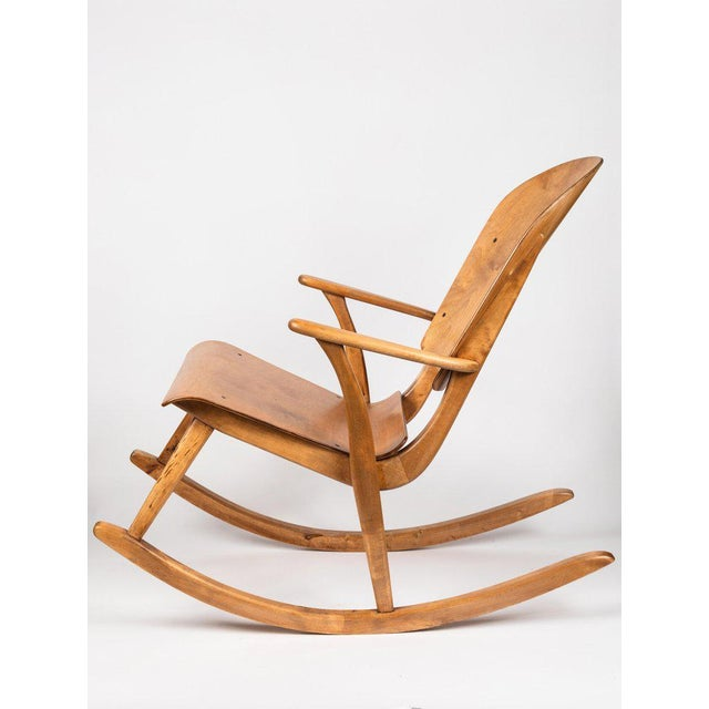 Rare Pair of 1940s Rocking Chairs by Ilmari Tapiovaara. These extremely rare and beautiful chairs were fabricated in...