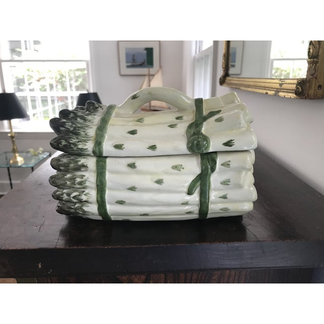 This wonderful vintage Portuguese Majolica asparagus tureen and lid feature cream colored asparagus with green tips and a...