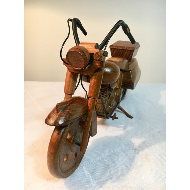 Very detailed wooden sculpture / replica of a motorcycle - Wheels turn and kick Stand functions allowing the bike to Stand...