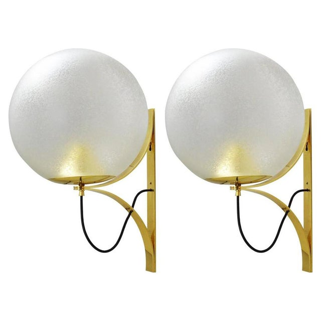 Vintage Italian wall lights with clear Murano glass globes with a beautiful etched frost using Acidato technique, mounted...