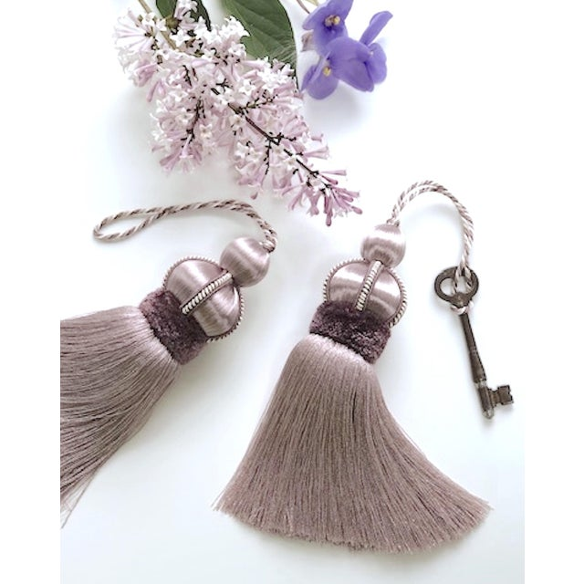 Pair of lilac colored key tassels with hand cut velvet ruche, decorative gimp and twisted cord detail. Total height, per...