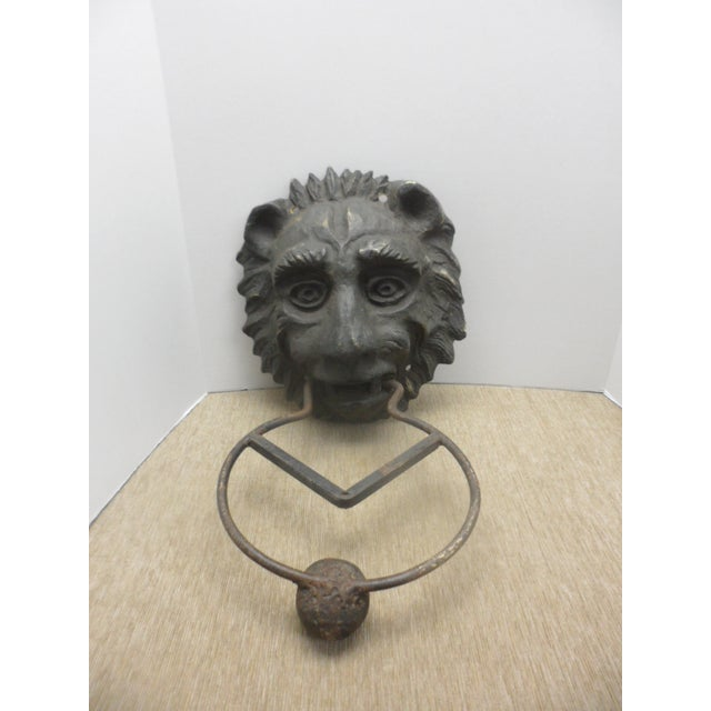"Measuring 23"" long and a little over 11"" wide, this lion's head is solid bronze and heavy. The bronze has a rich patina..."
