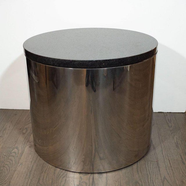 This refined occasional table was realized in the United States, circa 1970. It features a cylindrical body created from...