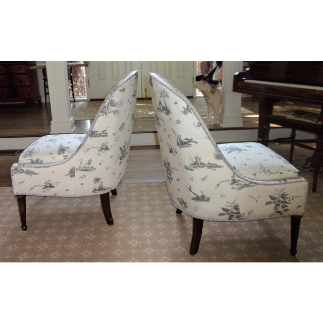 Two lovely chairs upholstered in Brunschwig & Fils, Chinoiserie Toile L'Americane fabric. The design is based on an...