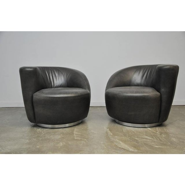 Pair of Vladimir Kagan Naultilus swivel chairs. Original grey leather with beautiful patina on chrome bases.