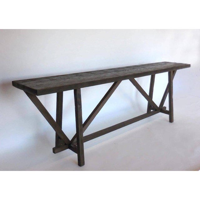 Reclaimed wood console with buttress base. This is the floor models which can be returned. There are no returns on custom...
