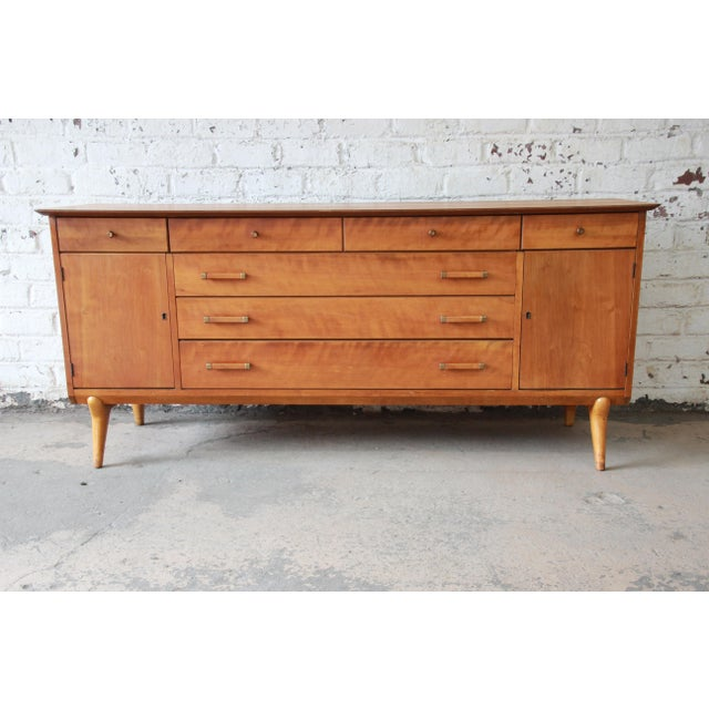 Offering an outstanding mid-century modern credenza or sideboard designed by Renzo Rutili for Johnson Furniture Co. The...