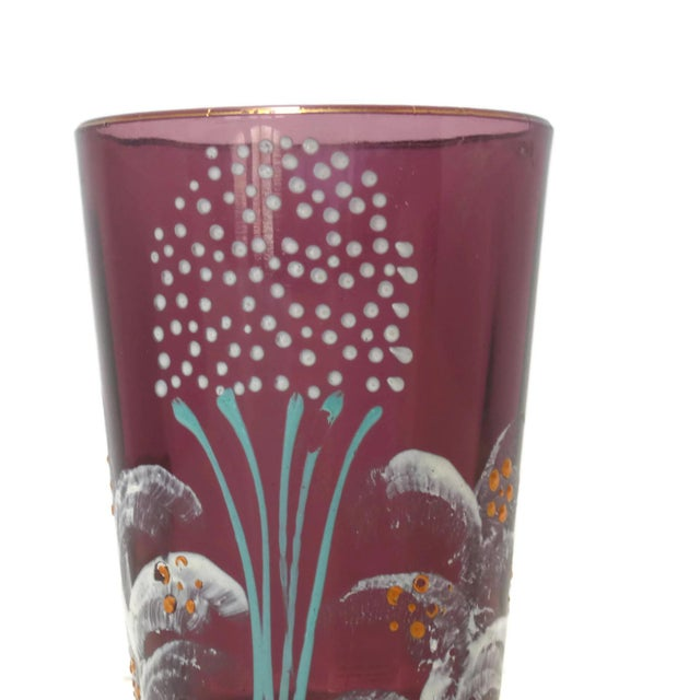 Offering a Victorian hand painted glass tumbler. This one is a deep shade of purple, hand decorated around the glass with...