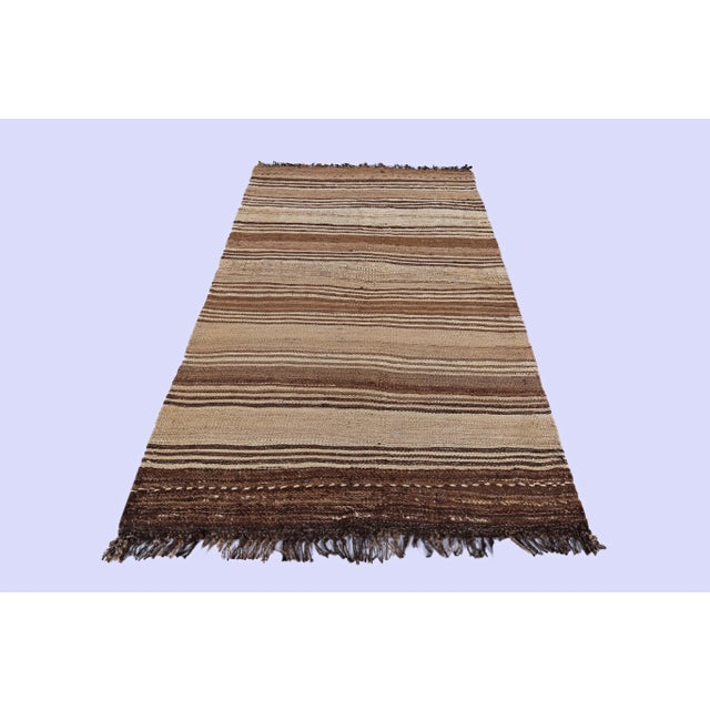 Contemporary Turkish rug handwoven from the finest sheep's wool and colored with all-natural vegetable dyes that are safe...