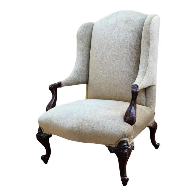 Antique Italian Wingback With Ornate Floral Carving For Sale