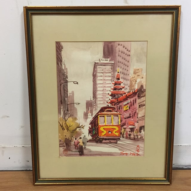 A framed watercolor signed painting of the city. Measurements are of the frame.