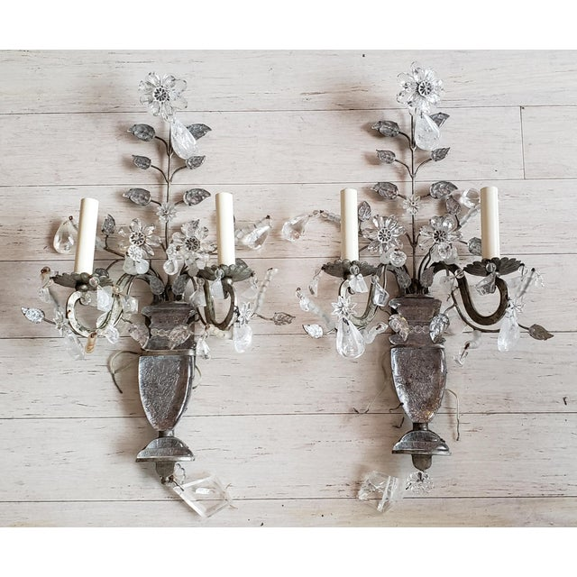 This pair of sconces are exceptional. The rock crystal with the silver leaf finish is remarkable. The floral adornment...