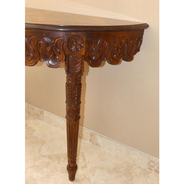 This demilune console table has it all... Italian Neoclassical styling, hand carved detail and inlaid marquetry wood top....