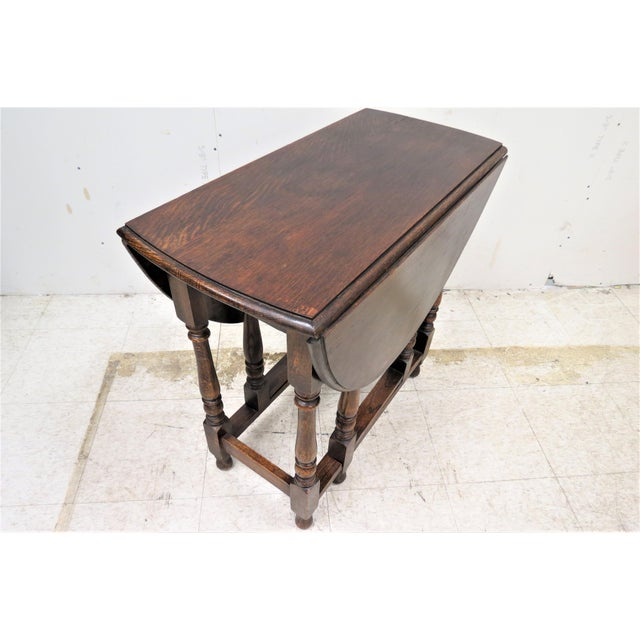 This lovely little table was imported from England. It is a small apartment sized drop leaf, gate leg dining table that...