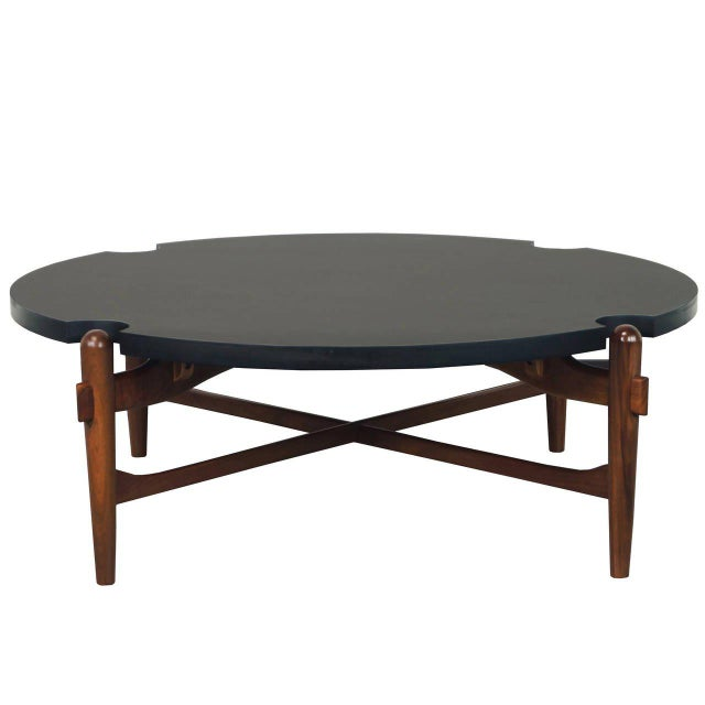 Vintage walnut coffee table features a round black laminate top with sculptural wood frame with cross-stretchers, original...