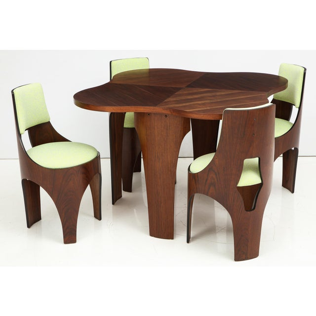 Table and four chairs of walnut and walnut plywood from the Cylindra line designed by Henry Glass and produced by Richbilt...