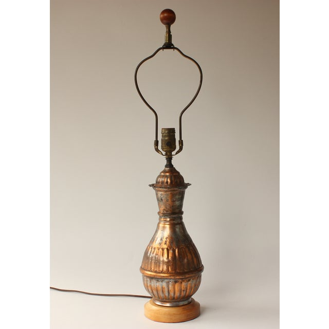 Made in Egypt, this vintage hand hammered copper lamp features an exotic, hand wrought form. Wired as-found; this lamp has...