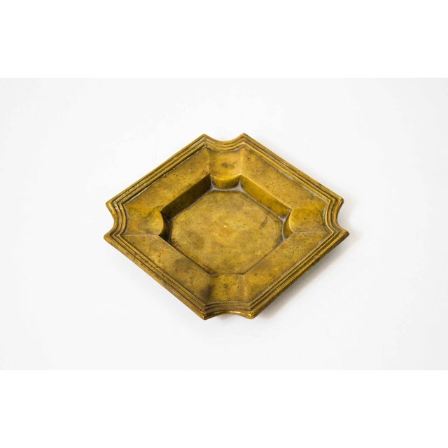 Charming aged brass catchall. Perfect for coins, rings, keys, or anything else that might clutter your surfaces and needs...