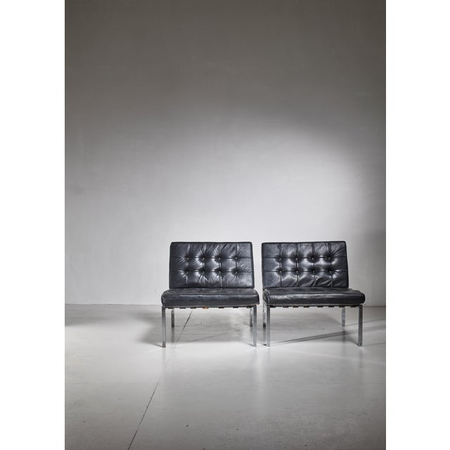 A pair of wonderful and luxurious KT 221 easy chairs by Swiss designer Kurt Thut. The chairs are made of a chrome-plated...