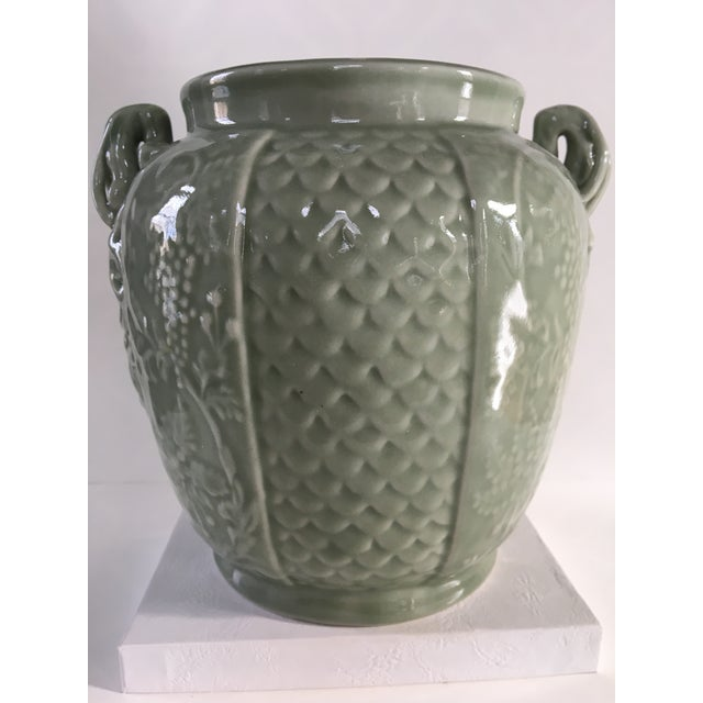 Beautiful, celadon green, two handled ginger jar/urn. This is a heavy piece with intricate embossed detail. The two...