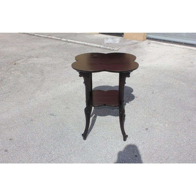 A French Art Deco two-tier Dark Mahogany accent or side table, circa 1940s .That rest on makes it ideal next to a long...