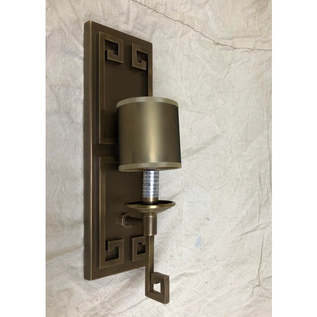 Greek Key Wall Sconce by Currey & Company - Showroom Sample Antique brass one-light wall sconce. Grecian fretwork. Comes...
