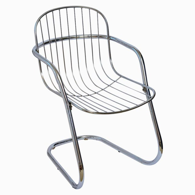 Set of f Italian designed chrome cantilever arm chairs, basket-style seats attached to tubular frames. This set is...