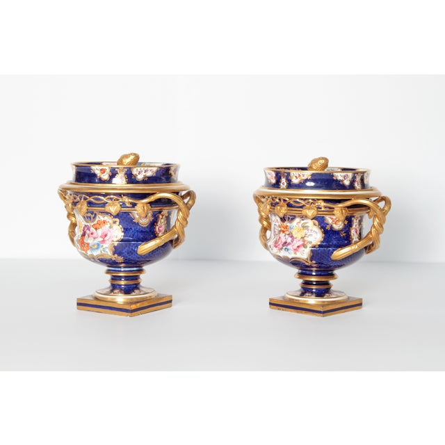A pair of English porcelain fruit coolers with covers. Square plinth base and pedestal supporting bowls with twisted gilt...
