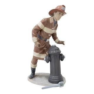 "Lladro ""The Fireman"" Porcelain Figurine No. 5976 Circa 1990s For Sale"
