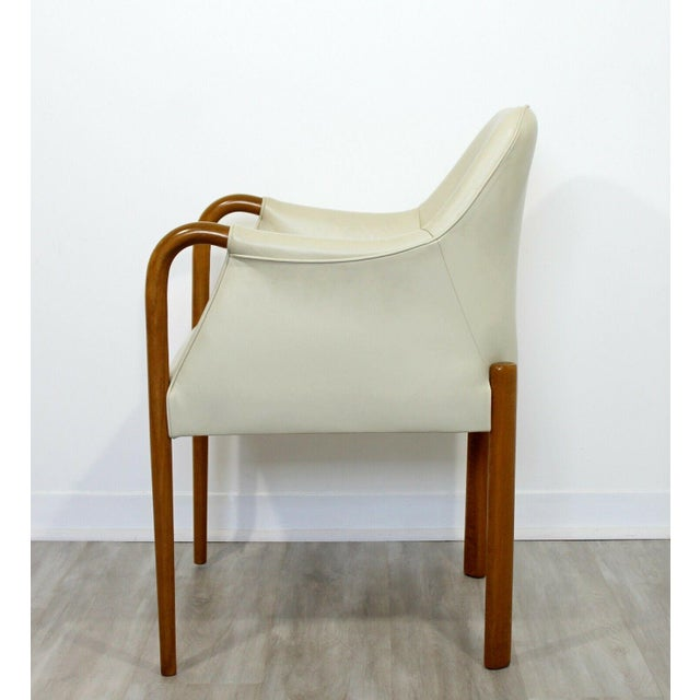 """For your consideration is a brilliant set of eight, beige leather and blonde wood, """"Progetti"""" dining armchairs, by..."""