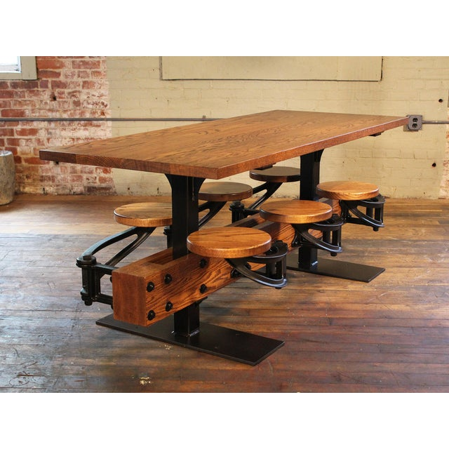 Industrial cafe table shown in oak – cast-iron swing-out-seat table built to suit. Options include number of seats, table...
