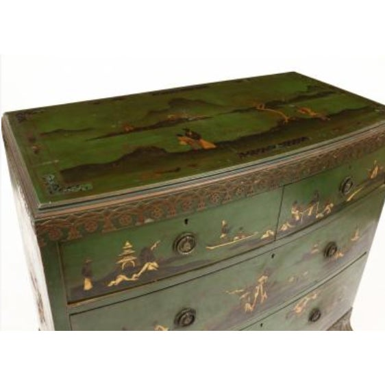 Circa 1940, green field with painted and gilt decoration, two over three drawers with applied fret wok frieze raised on...
