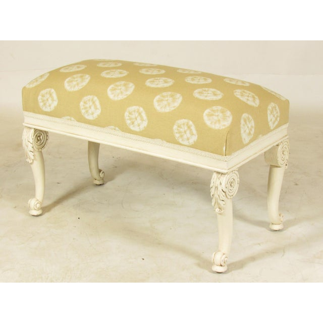 A late 19th century French hand carved bench seat with original off-white painted finish and new sand dollar motif fabric....