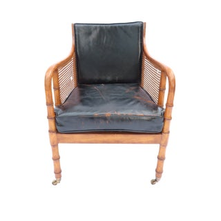 A Regency Caned Mahogany and Leather Bergere Library Chair, English Condition:-- For Sale