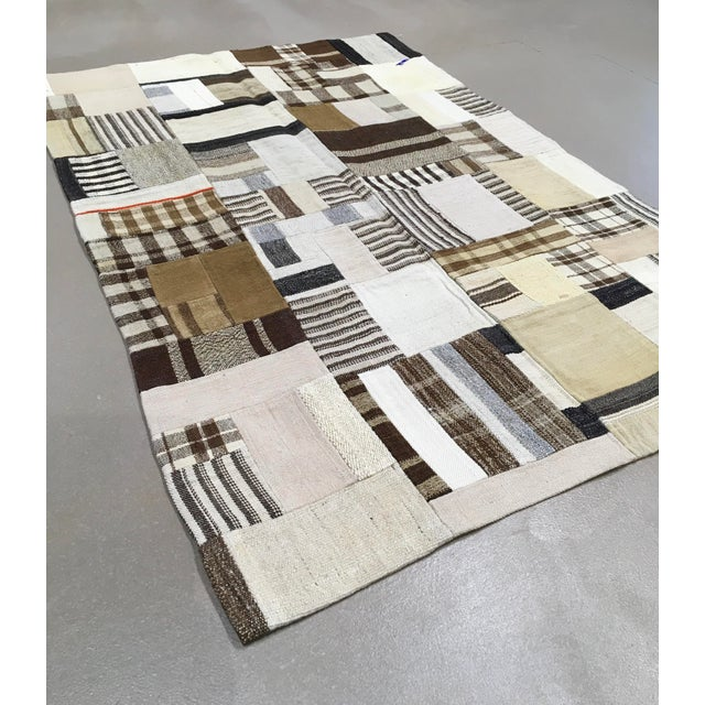 A rug comprising of a patchwork and variety of cloth hand sewn and backed to form a floor covering or wall hanging. Rugs...