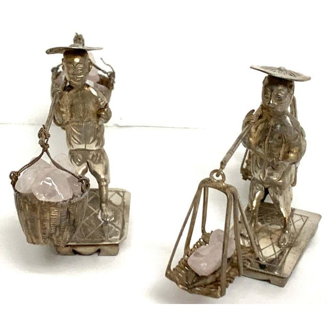 Pair of Chinese Export sterling figures of labourers carrying rose quartz Each one detailed and realistically cast, both...