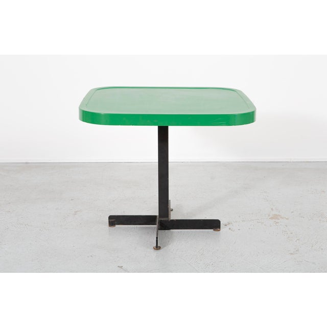 A green table designed by Charlotte Perriand for Les Arcs in France, c 1960s. Enameled metal.