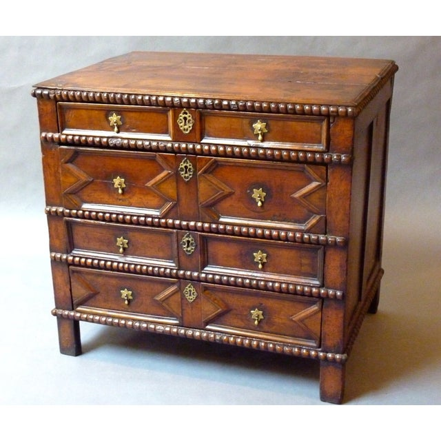 Extremely Rare 17th Century English Moulded Chest of Drawers. Made of solid cherrywood with a rich colour and deep...