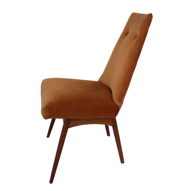 """Wonderfully comfortable accent chair. Upholstered in a soft muted orange velvet with two buttons. Seat height: 19"""". Very..."""