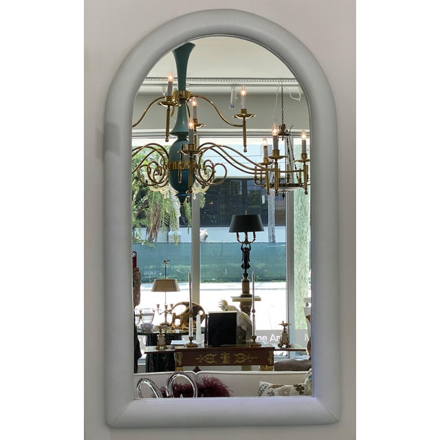 This stylish 1970s mirror is upholstered in a faux snakeskin vinyl and it is very much in the style of pieces created by...