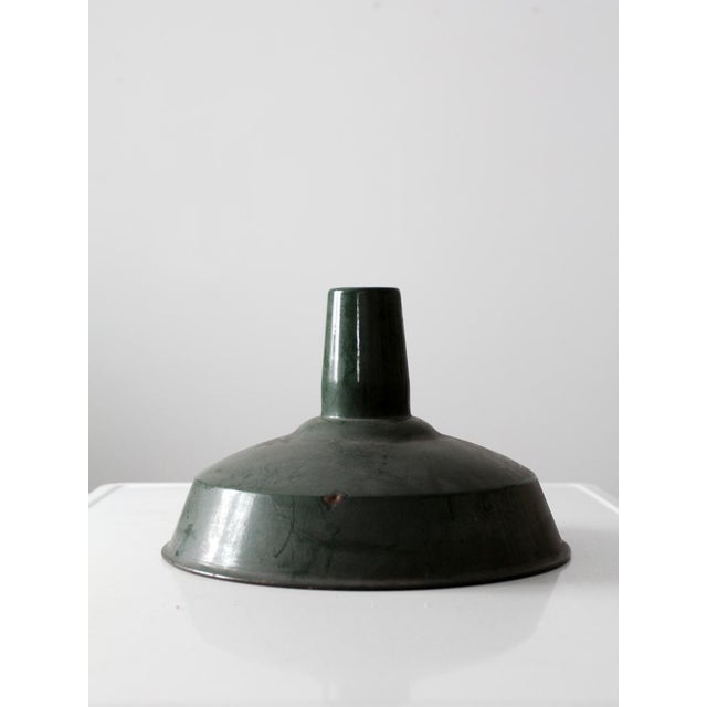 This is a vintage American warehouse pendant lamp shade. The classic metal shade features a green enamel exterior and a...